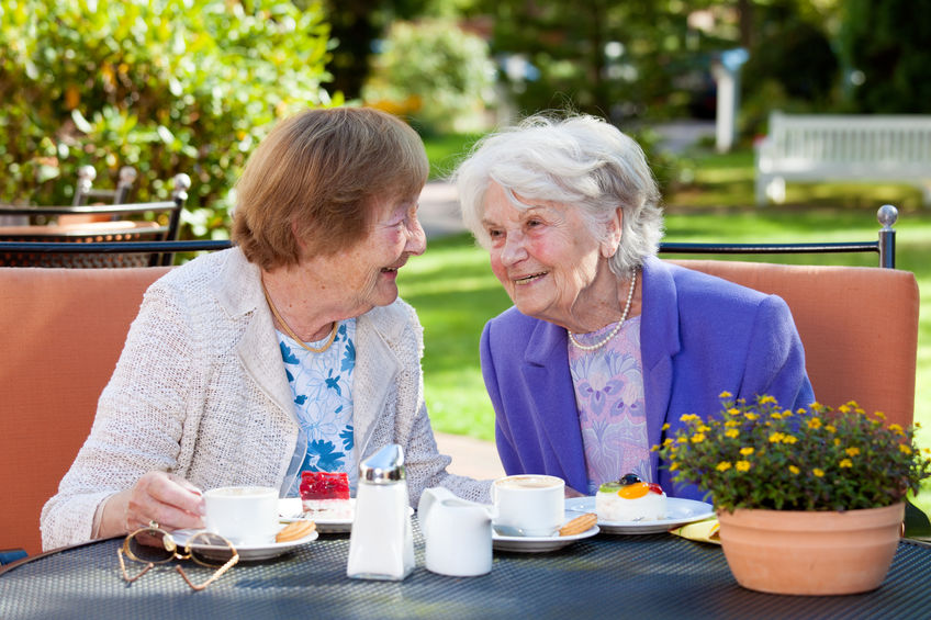 Two Senior Women Relaxing at the Outdoor Table